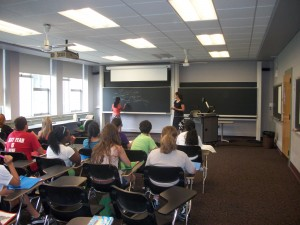 """Participants learn about Life Cycle Analysis, the idea that when measuring costs, you should worry about everything """"from cradle to grave"""". L-R: Brinda Thomas, Kim Mullins"""