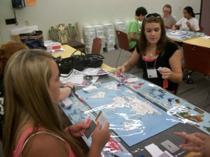 Participants play the climate game at the Museum of Natural History. L-R (Foreground): Brianna Barbarino, Hannah Murray, Melissa Gess, (Background) Ben Stern, Brianna Hill, Kristina Pacifico