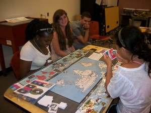 Idee has a winning hand during the climate game at the Museum of Natural History. L-R (Foreground): Idowu Olugbade, Bridget McKenna, Rodrigo Belo, Yiyi Zhang