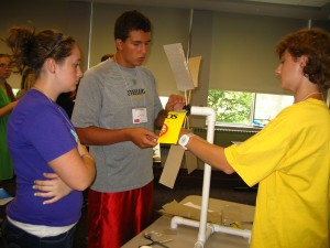 Participants measure output from solar cells. L-R: Chelsea Geruschat, Melissa Gess